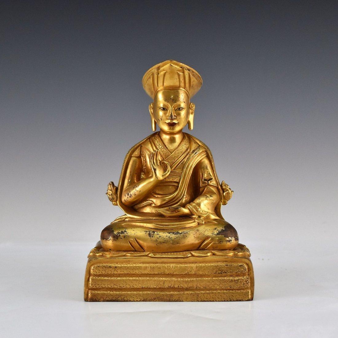 A GILT BRONZE BUDDHA FIGURE OF LAMA TSONDRU TASHI