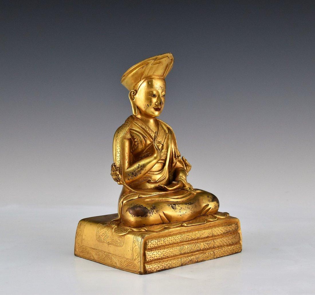 A GILT BRONZE BUDDHA FIGURE OF LAMA TSONDRU TASHI - 2