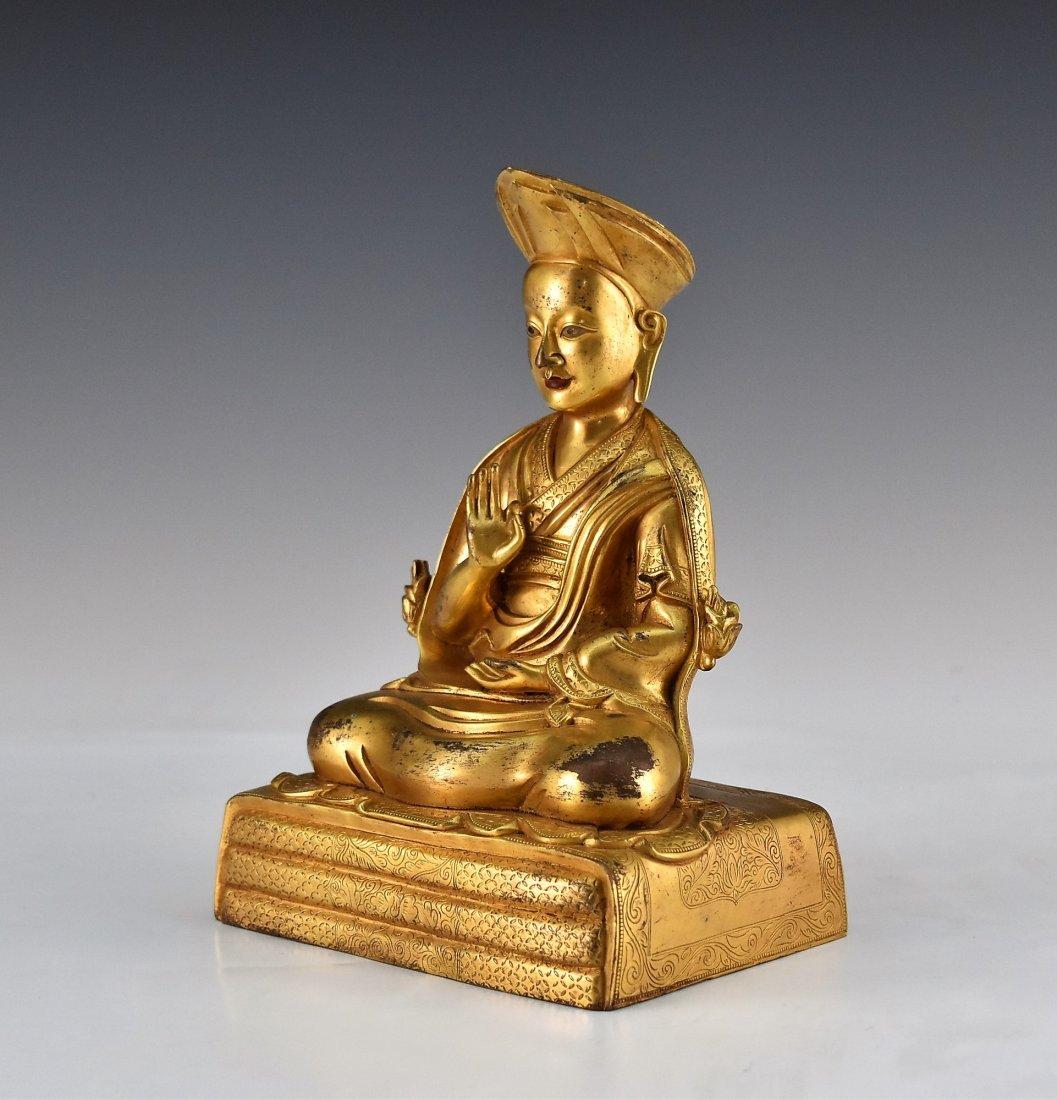 A GILT BRONZE BUDDHA FIGURE OF LAMA TSONDRU TASHI - 4