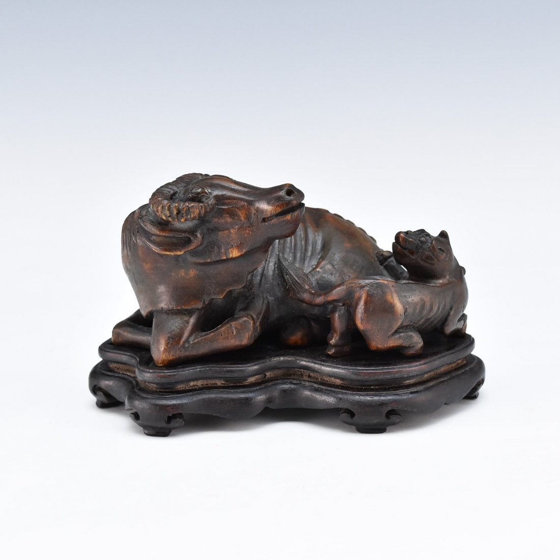 CARVED CHENXIANG WOOD OX AND DOG SCLUPTURE