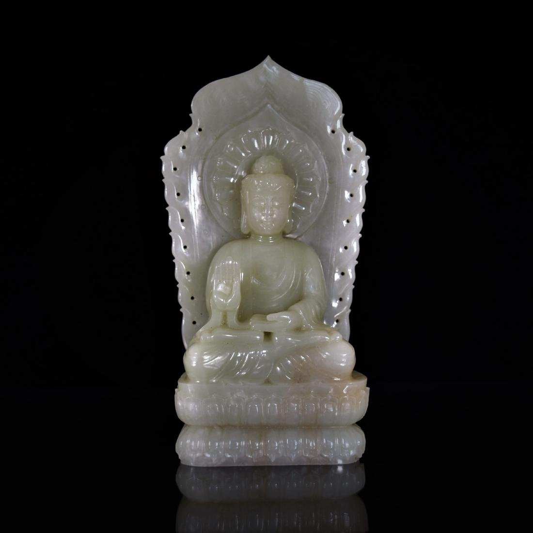 CARVED CELADON JADE OF SEATED BUDDHA WITH AURA CHAKRA