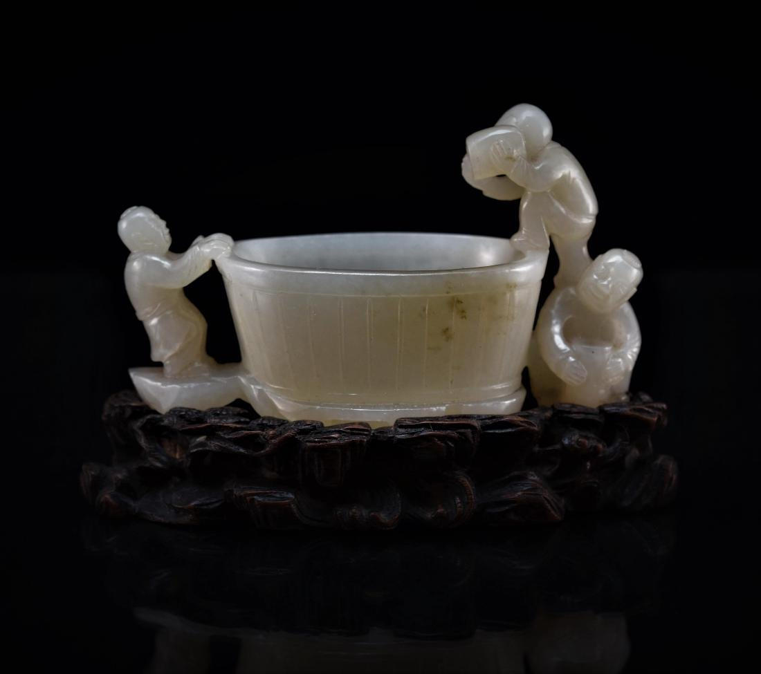 JADE BRUSH WASHER WITH THREE MONKS OVER BASKET MOTIF