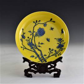 BLUE FLORAL MOTIF OVER YELLOW PLATE ON STAND