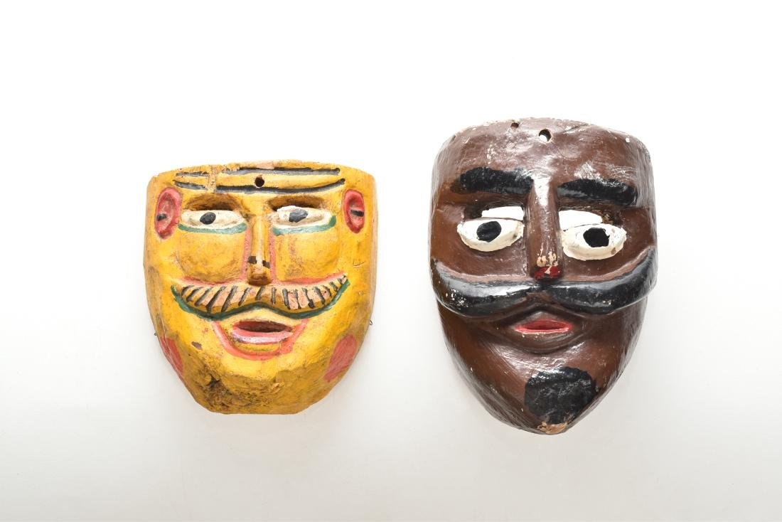 PAIR OF 2 CARVED MEXICAN WOODEN MASKS