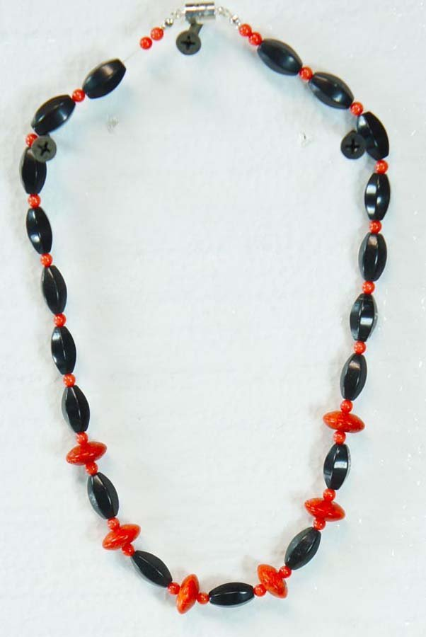 103:  CORRAL AND BLACK BEADS,   ,