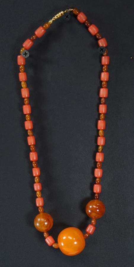 106:  RECONSTITUTED AMBER BEADS,  3 LARGE,  SMALLER AMB
