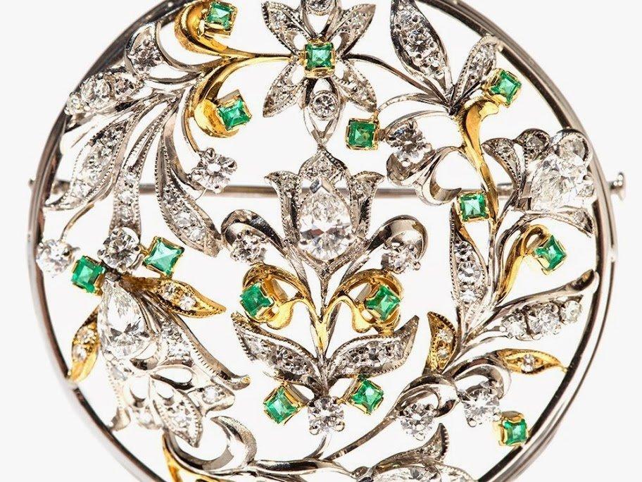 Soviet diamond and emerald 18ct gold foliate brooch