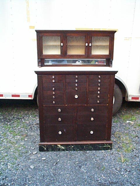 149M: Walnut dental/doctor's cabinet with white glass,