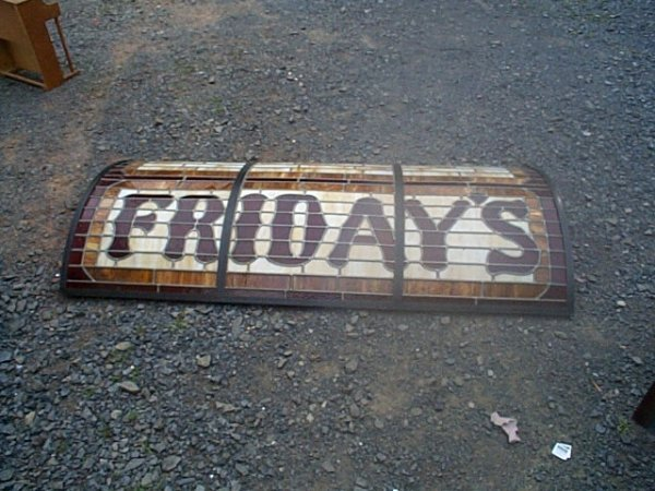500: Curved stained glass window with the word Friday's