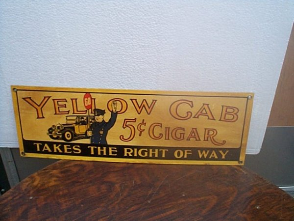 506: Porcelain Yellow Cab 5cent cigar advertising sign.