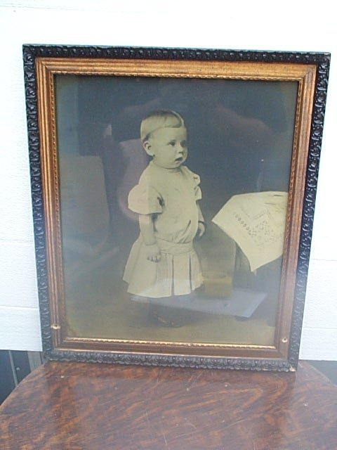 "514: Framed photograph of a young girl.  Measures 20"" t"
