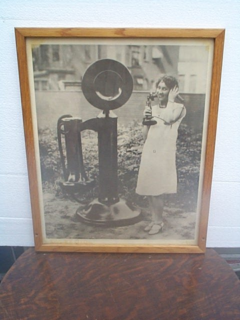 515: Framed print of a 1920's woman talking on a candle