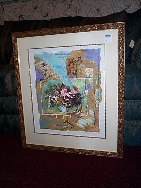 11: Framed collage depicting flowers, sheet music, and