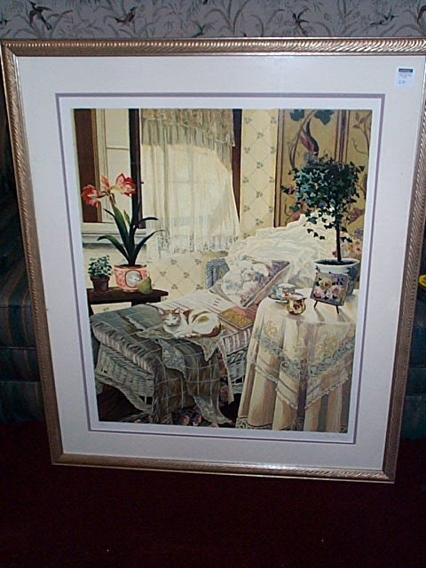 20: Framed print depicting a cat sleeping on a Victoria