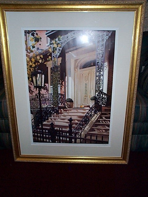 21: Framed print depicting the front steps and door of