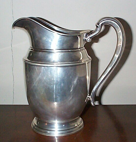 3: sterling silver water pitcher