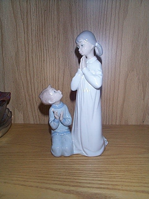 1: Lladro figurine, depicting a girl and young boy knee