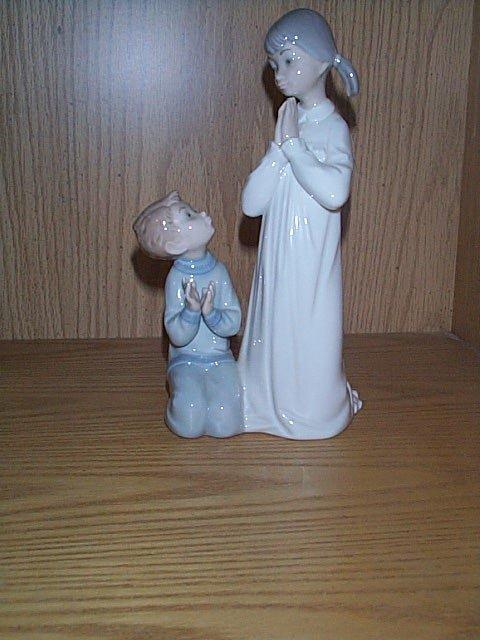 4: Lladro figurine, depicting a girl and a young boy kn