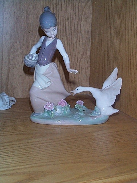 5: Lladro figurine, depicting a girl collecting goose e
