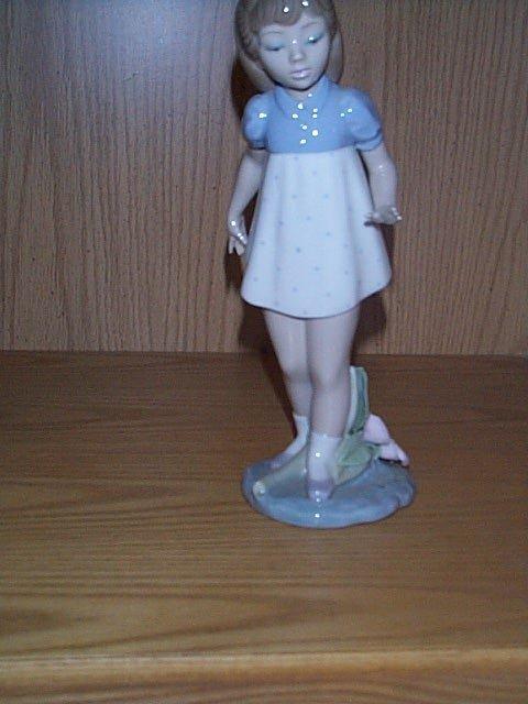 9: Lladro figurine, depicting a young girl walking.  Ha