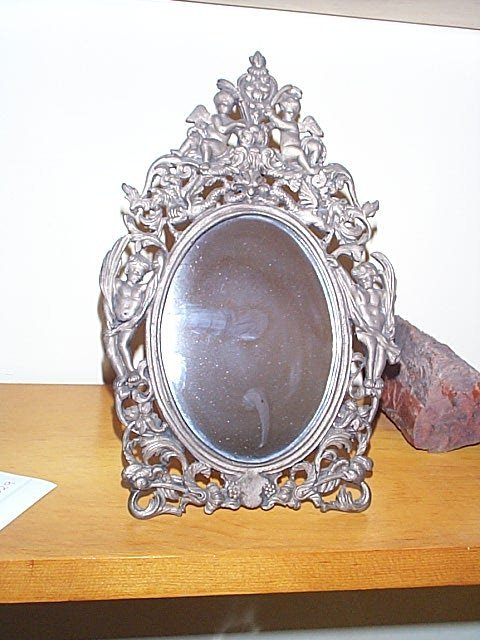1006: Mixed metal decorative and figural mirror.  Measu