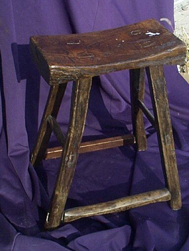 "1016: Craved wood stool/bench.  Measures 20"" tall by 15"
