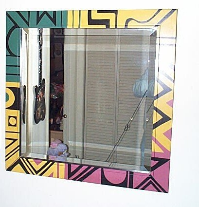 210: South Western style, beveled glass mirror with a p