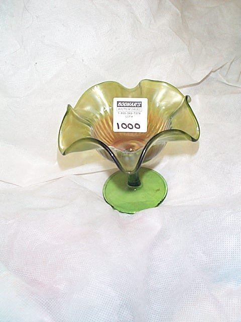 1000: Carnival glass smooth rays green compote signed,