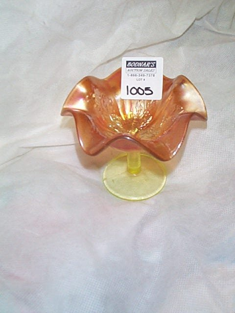 1005: Carnival glass ribbed holly marigold compote with