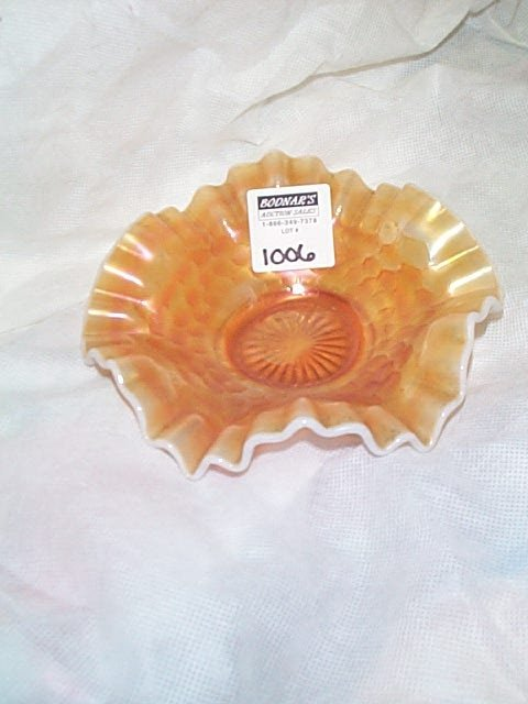 1006: Carnival glass over yellow slag elephant candy co