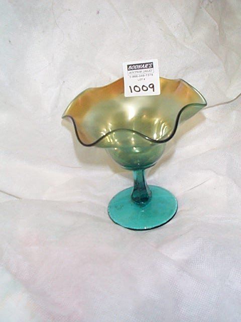 1009: Carnival glass teal green compote.  Unsigned, pos