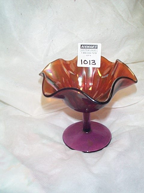 1013: Carnival glass amethyst and amber color compote.