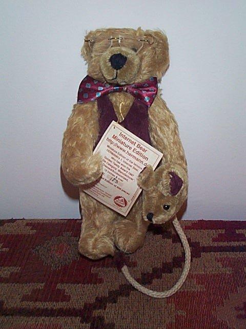"1008: Hermann 10"" Mohair jointed teddy bear holding a m"