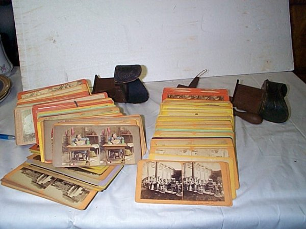 2141: Lot of 2 hand-held stereo viewers with approximat