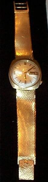 14K Bulova Accutron men's watch with attached 14K me