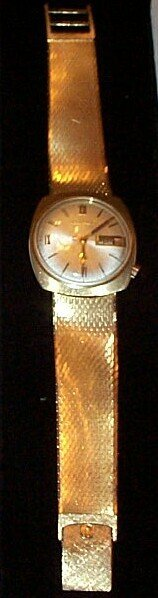9: 14K Bulova Accutron men's watch with attached 14K me