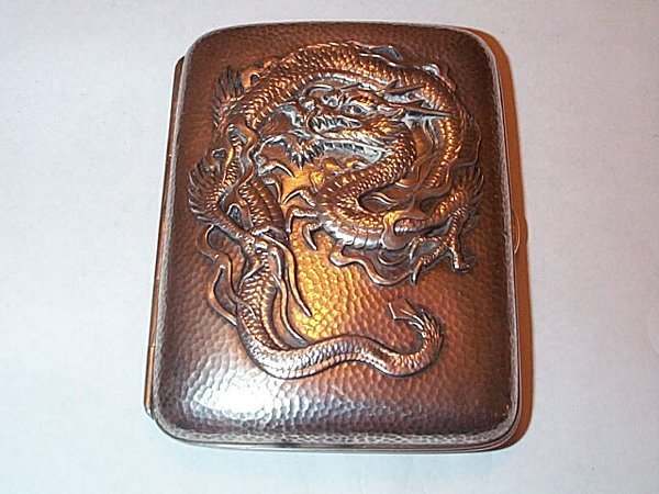 14: Victorian silver cigarette case with an intricate d