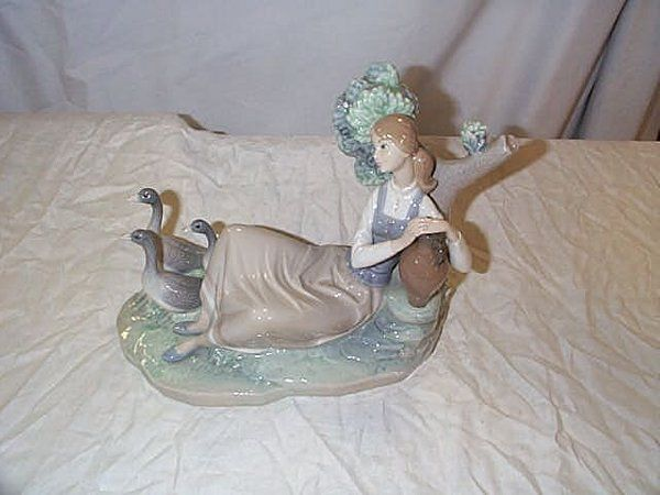 """Lladro number 1212 """"Woman Carrying Water"""" with gee"""