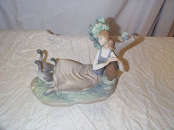 """501: Lladro number 1212 """"Woman Carrying Water"""" with gee"""