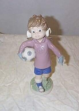 """Lladro number 5134 """"Sports Lilly Football"""", retire"""