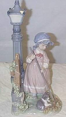 """Lladro number 5286 """"Fall Clean Up"""", item is as fou"""