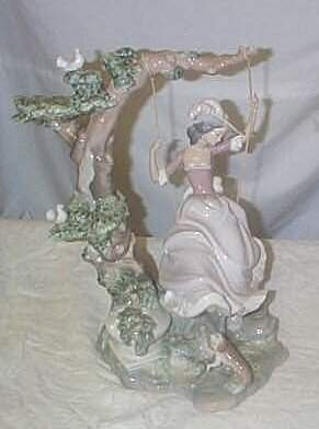 "Lladro number 1297 ""Victorian Girl on Swing"", reti"