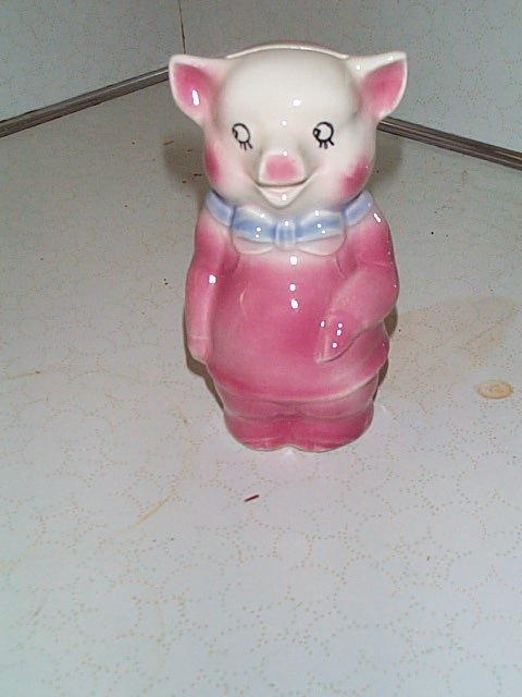 4: American pottery piggy bank. Measures 6 inches tall.