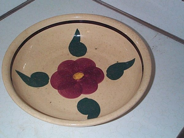 10: Signed ovenware USA pottery bowl. Measures 13 inche