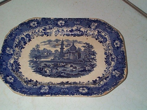 12: Blue & white transferware platter. Has some chips a