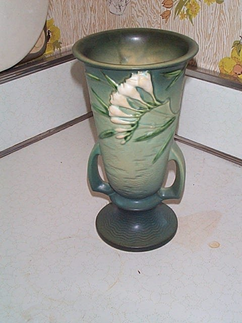 13: Roseville Freesia double handled vase. Does have a