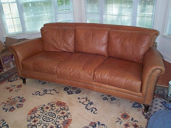 154: 10 year old leather sofa, chair and ottoman in goo