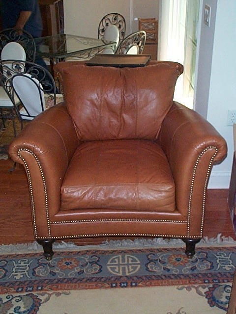 154: 10 year old leather sofa, chair and ottoman in goo - 2