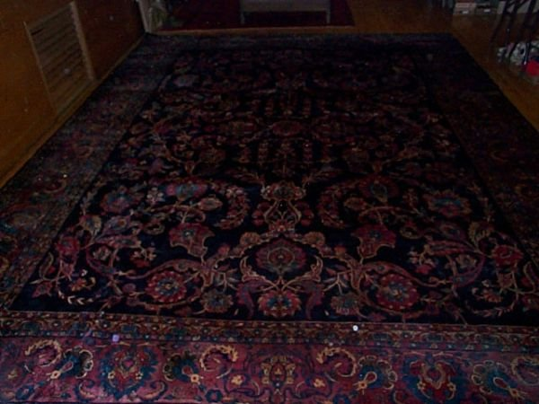 145E: Antique hand-made roomsize rug in excellent condi