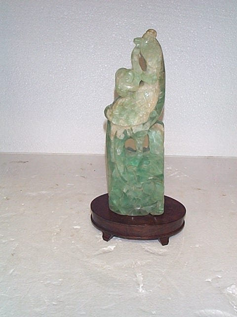 509: Antique Jade figurine measures 12 in tall by 3.5 i